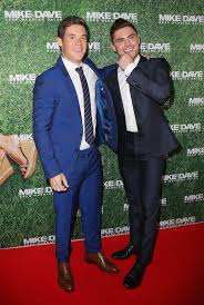 best ideas about adam devine modern family pin for later zac efron and adam devine are heating things up down under at