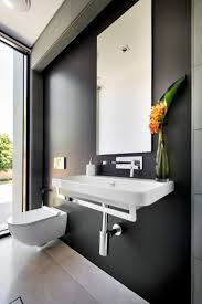 architecture bathroom toilet: architecture white modern toilet and white sink bathroom faucet single hole mirror bathroom black wall