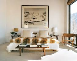 white accent wall in inspiring bedroom design with fur bedding style and wood side tables and aspen white painted bedroom