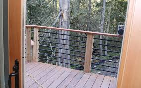patio railing design ideas this deck railing has a wooden top with horizontal metal rails