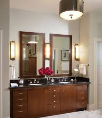 lights captivating wooden vanity applying dark brown color combined with black marble countertops completed with double washbowl bathroom vanity lighting ideas combined