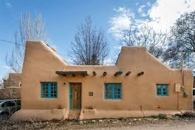 A Pueblo style solar house in Santa Fe   Small House BlissA s Pueblo Revival style adobe home retrofitted   a rooftop active solar system  It