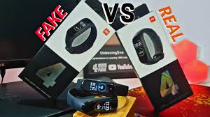 How to Spot is Your <b>Mi Band</b> 4 Fake or <b>Original</b>? || Comparing both ...