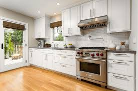 modern kitchen cabinet hardware traditional: hardware for white kitchen cabinets kitchen traditional with bridge faucet ceiling lighting