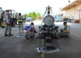 u s department of defense photo essay u s airmen measure and weigh an excess fuel tank on aviano air base