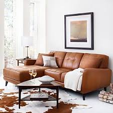 living room leather furniture pinterest couch tufted leather sectional brown cowhide rug living room furniture