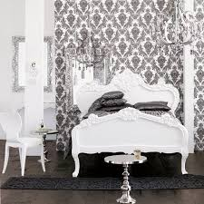 black and white bedroom damask wallpaper chandelier white elaborate carved bed modern black white style modern bedroom silver