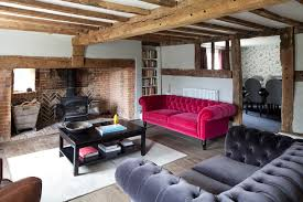 family house in east sussex example of a country formal living room design in sussex with brick living room furniture