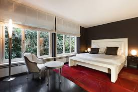 this bedroom proves there are different shades of black the black used on the feature wall is a velvety black with just a hint of red which gives it a black bedroom furniture hint