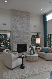 ideas contemporary living room: contemporary living room with floor to ceiling light grey stacked stone fireplace