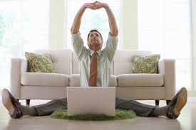 work at home today businessman stretching while working on his laptop