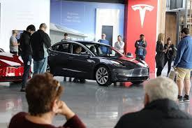 DealBook Briefing: Tesla
