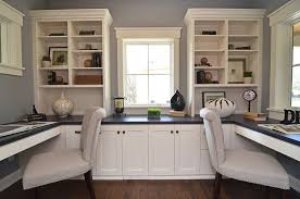 chanhassen cottage new construction traditional home office idea in minneapolis with a built in desk and built in home office furniture