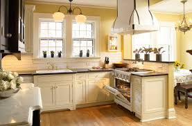 in style kitchen cabinets: graceful cream kitchen cabinets black granite countertops images of in style design cream kitchen cabinets with black countertops