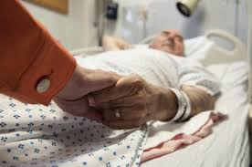 arguments for and against euthanasia care the arguments against euthanasia man lies on hospital bed holding w s hand