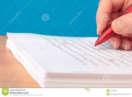 hand pen proofreading a resume by laptop royalty stock hand red pen proofreading a manuscript stock photos