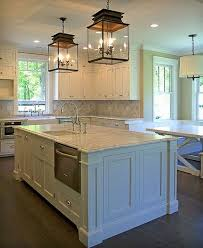 traditional kitchen with a pair of glass pendant lanterns center island lighting
