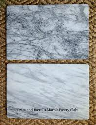 calacatta marble kitchen waterfall: while  crate and barrel marble pastry slabs copy