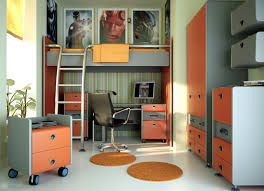 office and workspace space saving idea for teenage bedroom with loft bed and study desk under bed and metal ladder and orange red closet and mesh back chair bunk bed office space
