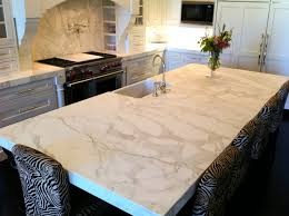 calacatta marble kitchen waterfall: projects like this are such fun for us to work on