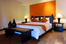 light orange headboard area bedroom colors with black furniture bedroom with black furniture
