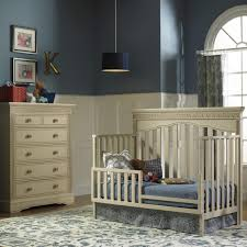 decorating ideas light blue walls baby dark subtle tones in this nursery include beige convertible crib and m