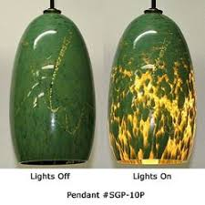 picture of limited edition green speckle blown glass pendant lights artisan blown glass lamps