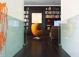 view in gallery home library in dark tones sports a charming egg chair by arne jacobsen in bold orange arne jacobsen style egg