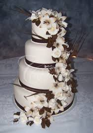 2012 wedding cakes creations by laura fondant covered wedding cake white gumpaste roses white and brown star flowers and