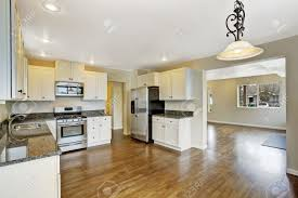 room spacious open plan interior in empty house with open floor plan spacious kitchen room wit