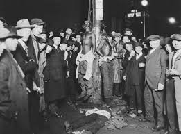 A group of young black men hung lynch style by the Christian group, the KKK.