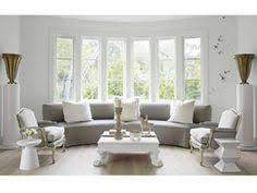 a light filled living room bay window furniture