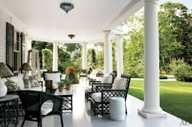 black and white patio with black wicker furniture with white cushions antique rattan chairs also black outdoor furniture