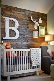 this modern woodland nursery featuring a wood pallet accent wall is all boy baby boy rooms