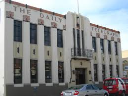 the local newspaper office from the 30s its now a realty company but the art deco office building