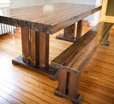 modern dining table teak classics: natural oak farmhouse style dining table in minimalist dining area with long teak bench on hardwood