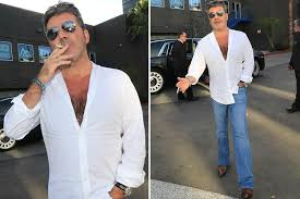 quit plans up in smoke Simon Cowell seen with cig despite vowing ...