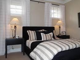 basement bedroom light beige walls dark furniture striped bedding that pulls in beige basement bedroom lighting ideas