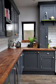 Water Resistant Kitchen Cabinets Get Moody With Dark Walls Cabinets Hand Painted And Countertops
