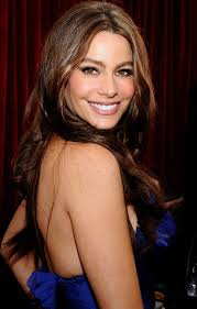 Star of the show is Columbian bombshell Sofia Vergara, admired by men for her obvious assets and by women for her exotic beauty and cat's eyes. - Sofia-Vergara-blue-dress
