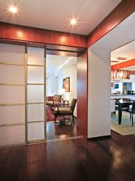 view from entry example of a mid sized trendy foyer design in new york architects sliding door office