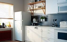 adorable ikea small kitchen decorating ideas with white kitchen cabinet on combined white countertop also black