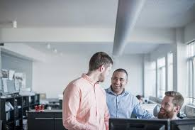 positive communication skills and relationship building for 3 men communicating at work