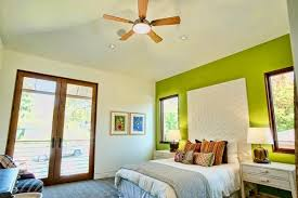 image of inspiring led bedroom lighting fixtures mounted on wooden blade ceiling fan above striped cotton bedroom overhead lighting