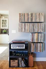 floating record shelves by mike zimmerer of zimm metalworks via designsponge front shot finished vinyl record