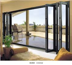 door patio window world: outside  exterior accordion doors folding patio doors aluminium with foliages in the vase and white fence outside