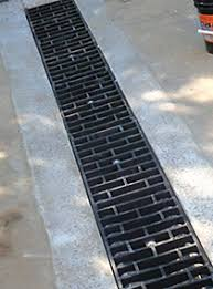 trench drain decorative plastic grates grating econodrain trench forming system driveway installation of econodrain