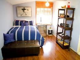 stunning boys small bedroom ideas with dark brown wooden vertical shelves above wood floor and brown charming bedroom ideas red
