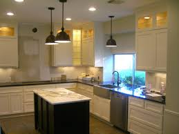 modern kitchen pendant lamp with recessed lighting in white ceiling also black island also white cabinetry black modern kitchen pendant lights