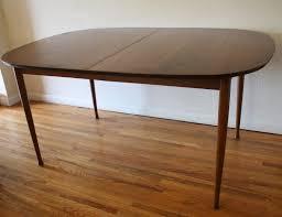century modern walnut dining chair knoll walnut  mcm oval surfboard dining table
